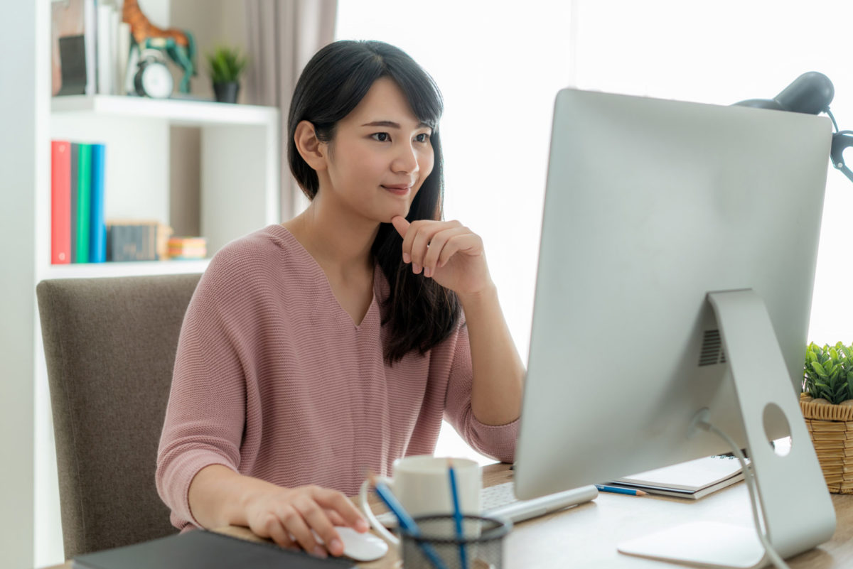 oung businesswoman using computer work from home for protect virus and take care of their health from COVID-19. Working at home and social distancing concept.